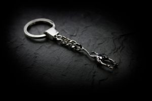 Key chain with 'Rider' sculpture